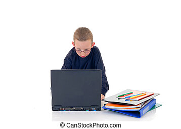 Doing school work - Young boy casual dressed, doing homework...
