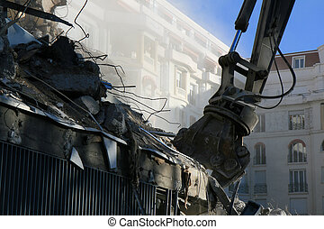 Demolition Job - Part of a building being demolished with a...