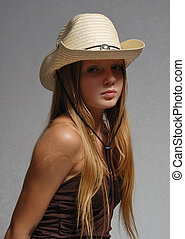 Young model with hat on head
