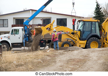 Dumping Gravel - City workers replacing a fire hydrant, and...