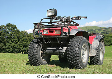 Quad Bike - Red and black four wheel drive quad bike...
