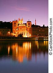 Lyon at dusk - The Notre Dame de Fourviere basilica and the...