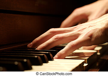 Piano Hand - A Caucasian male\\\'s hand playing a piano in...