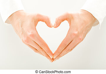 Symbol of heart - Image of woman�s hands made in the form...