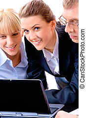 Business people - Image of three business people with a...