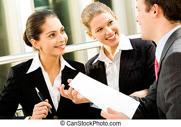 Business group - Group of three young business people are...