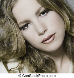 Blond model with curly hair - Portrait of a beautiful blond...