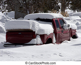 Buried - Red pickup truck buried after a mountain snowstorm