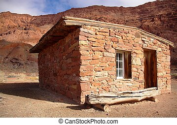 Stone Cabin - Old sand stone cabin with door and window in a...