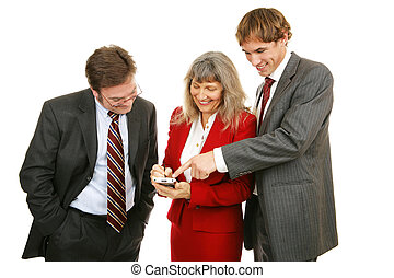Business Team Plays Game - Business team enjoying a handheld...
