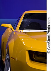yellow car - yellow sports car with a blue background