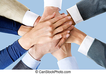 All for one! - Photo of business people�s hands on top of...