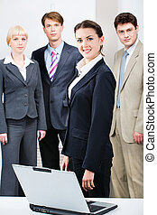 Successful people - Confident woman in suit standing in...
