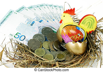 Prosperity - Mechanical toy chicken in a nest with cash and...