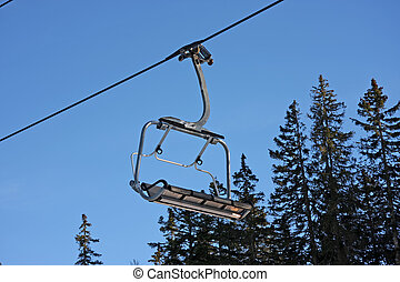 Cable car - Empty ski cable car with trees in the background