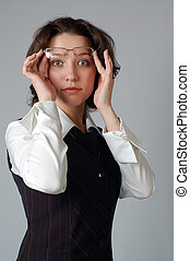 business surprise - business woman looking rather suprised,...