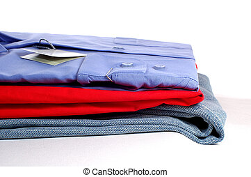 new clothers - some new clothers on grey podium, isolated on...