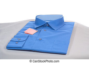 blue shirt - new blue man shirt on grey podium, close-up,...