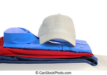 some clothers and a hat laying on the grey podium