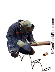 man cutting a pipe - a man holding and cutting a rusty pipe