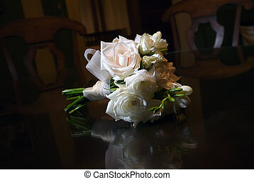 Bridal bouquet on wood table - image of a bridal bouquet on...