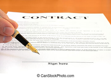 Signing contract - Male hand holding fountain pen pointing...