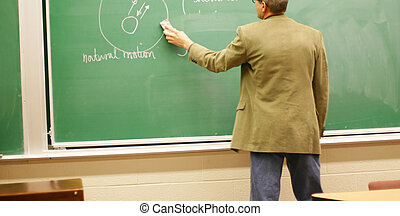 professor teaching - older man wearing jacket stands as he...