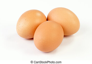 Fresh Eggs - Close up of three brown eggs on bright...