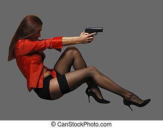 Women with big black gun - Women in red with big black gun