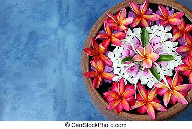 Floating flowers - Tropical flowers floating in water. Taken...