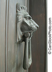 lion head door knob - side view of a lion shaped door...