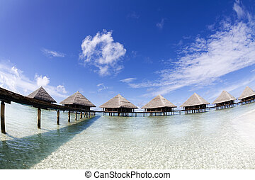 tropical beach: tropical resort and cloudy sky
