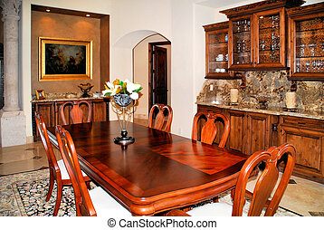 lovely dinning room with wooden table and nice buffet...