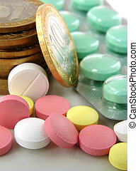 pills and coins - assorted colorful pills with coins...