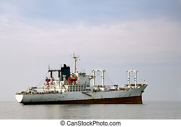 White merchant ship - Image shows a white merchant ship...