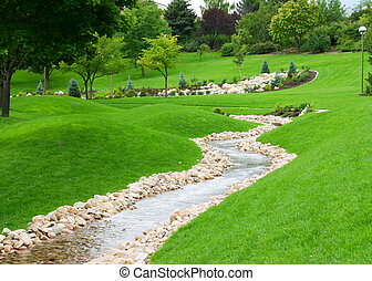 zen garden - stream of water flowing through grassy hills...