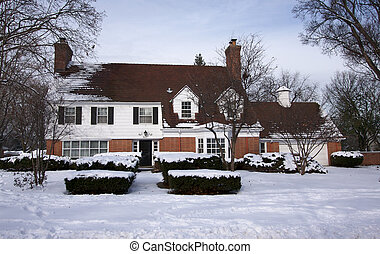 Majestic Newly Constructed Home Facade on a Snowy Winter Day