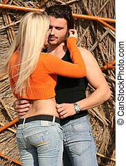 Couple in a romantic pose - A young blonde couple hugging...