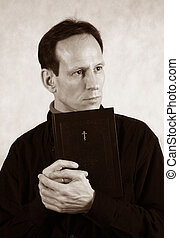 Man with bible - Thoughtful the man with the bible on a...