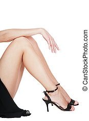 Hand and legs - Long beautiful legs of woman in black dress...