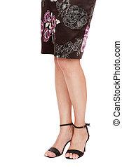 Pretty legs - Long beautiful legs of woman in brown silk...