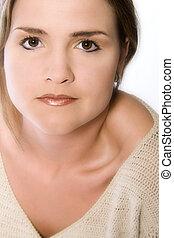 young woman making eye contact - Young caucasian woman in...