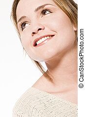 young woman looking up smiling