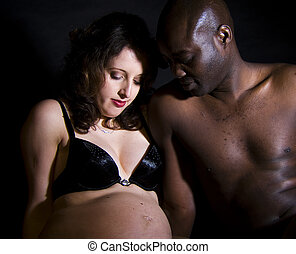 Mixed race pregnant couple