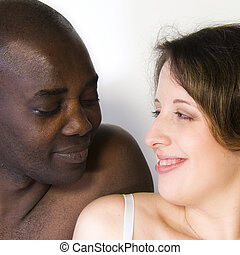 Mixed race couple - a mixed race couple portrait in the...
