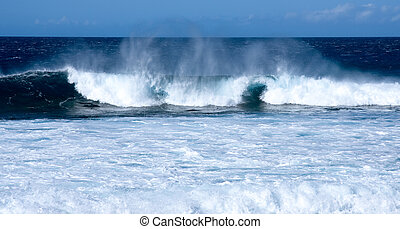 Waves crashing on beach - Waves off the coast of Hawaii on...
