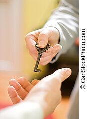The key to succes - Hands exchanging the key to success
