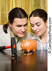 Making money - Couple looking for money from piggy bank