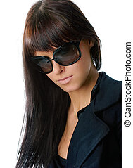 Woman in glasses - Young and fashionable girl posing in sun...