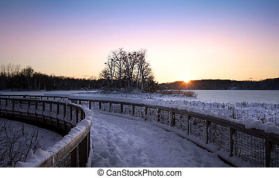 Snow Covered Board Walk - Winter landscape with colorful...